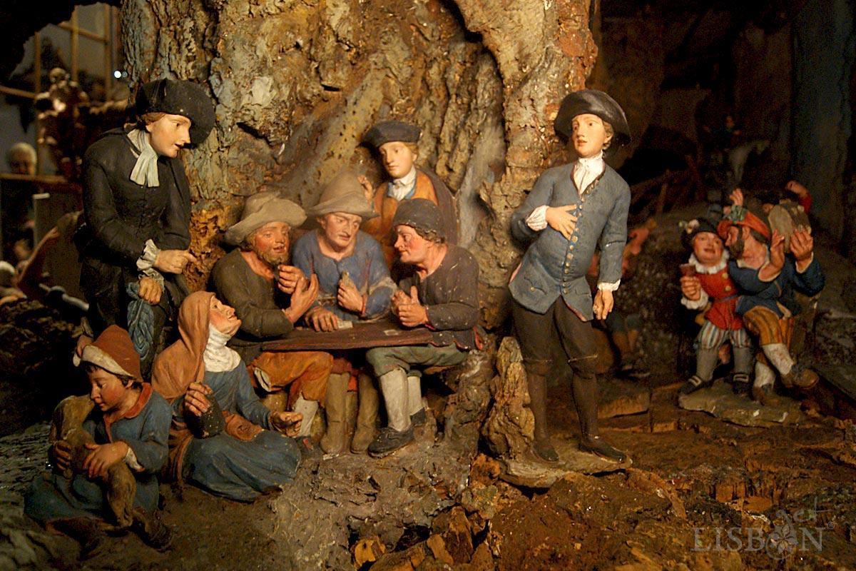 Figuras contemporâneas do séc. XVIII. Na tradição dos presépios portugueses podemos observar cenas típicas da sociedade da época.