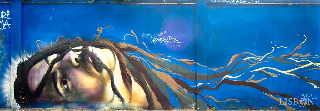 A Arte Urbana Rostos do Muro Azul. Intervenção de Granje.